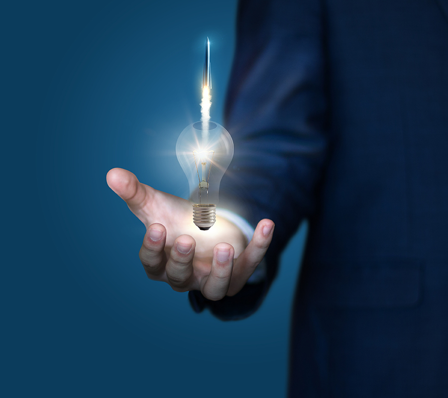 business man holding light bulb that represents an idea